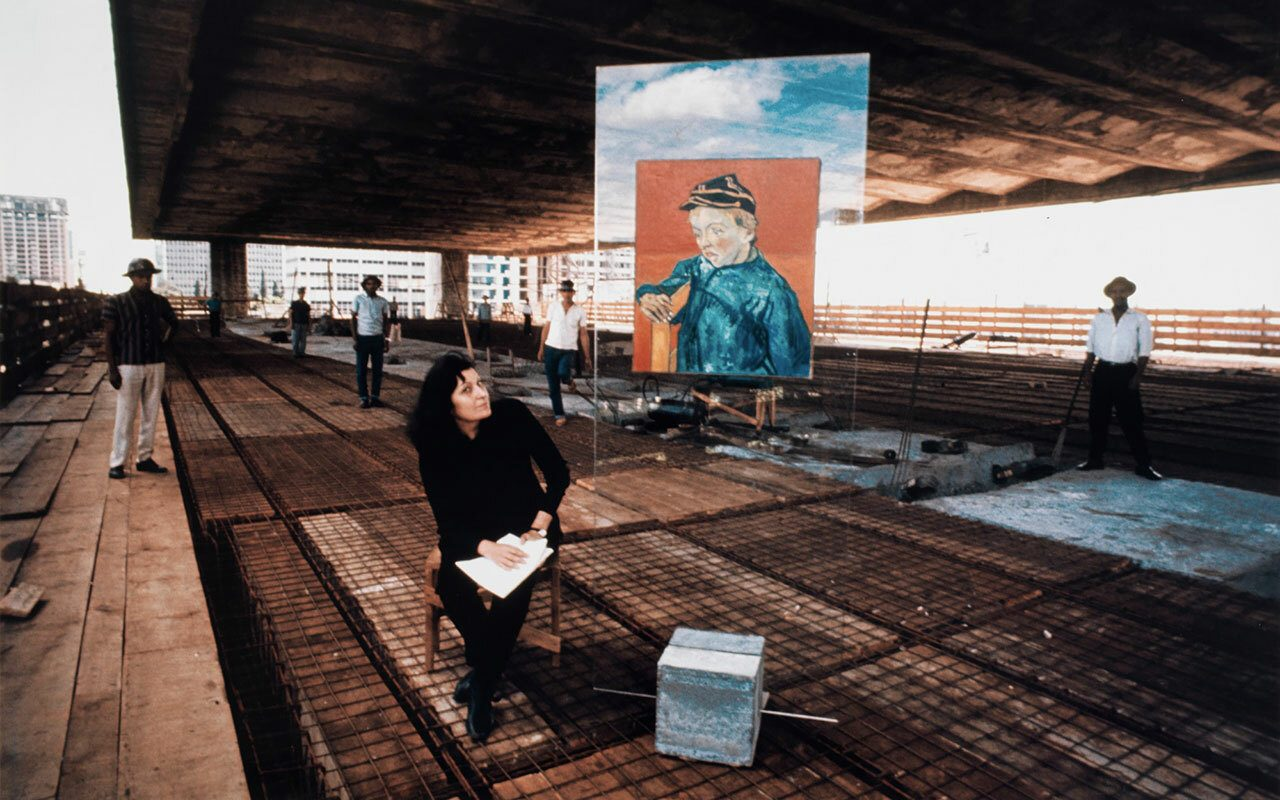Portrait Lina Bo Bardi and glass easel with a Van Gogh at MASP construction site courtesy Instituto Bardi